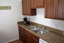 Newly renovated kitchens with brand new wood cabinetry and granite-look counter tops.